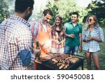 Happy people having camping and having bbq party outdoor