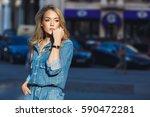 street style. beautiful woman... | Shutterstock . vector #590472281