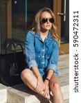 street style. beautiful woman... | Shutterstock . vector #590472311