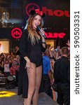 Small photo of Ukraine Kiev August 13, 2015 Vocalist in the club. Young and beautiful vocalist Nadya Dorofeeva singing in the club with a lot of fans on background.