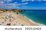 a beach in portugal with beach... | Shutterstock . vector #590510405