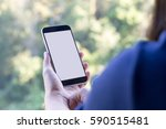 woman's hand holding smartphone ... | Shutterstock . vector #590515481