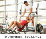 young man and woman doing chest ... | Shutterstock . vector #590527421