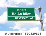 green overhead road sign with a ... | Shutterstock . vector #590529815