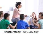 Female Teacher Conducting...
