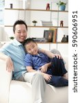 father and son in living room ... | Shutterstock . vector #590606951