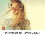 blonde girl in windy day  with  ... | Shutterstock . vector #590625314