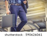 Small photo of Business man holding a briefcase walking up the stairs in the routine of working with determination and confidence.