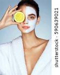 lovely girl holding a slice of... | Shutterstock . vector #590639021