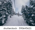 chairlift passing through the...   Shutterstock . vector #590645621
