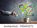 hand of businessman watering... | Shutterstock . vector #590653271