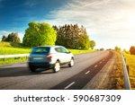 asphalt road on dandelion field ... | Shutterstock . vector #590687309