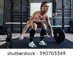 extreme workout  muscular... | Shutterstock . vector #590705549