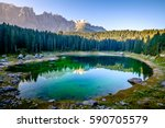 karerlake in italy - Lago di Carezza - at the background the dolomites - stock photo