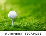 golf ball on tee ready to be... | Shutterstock . vector #590724281