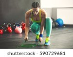 young fit woman is taking... | Shutterstock . vector #590729681