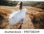bride in wedding dress running... | Shutterstock . vector #590738249