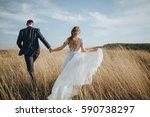 groom and bride in a wedding... | Shutterstock . vector #590738297