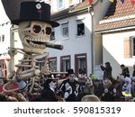 Small photo of Weil der Stadt, Germany - February 26, 2017: A vehicule is referring to Dia de los Muertos, an important Mexican holiday, while taking part on the traditional festive and cultural carnival procession