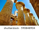 the columns with hieroglyphs in ... | Shutterstock . vector #590848904