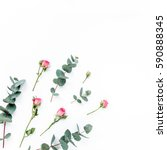 Stock photo floral pattern made of pink roses green leaves eucalyptus branches on white background flat lay 590888345