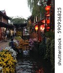 Small photo of Evening Lamps lighting gardens abounding with Camellia, Peony, Magnolia, Azaleas,Gentian and Chrysanthemum flowers for which Li Jiang Old City are famous, Yunnan, China.