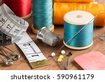 spools of thread and basic... | Shutterstock . vector #590961179