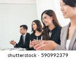 asian business group applaud in ... | Shutterstock . vector #590992379