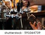 close up of bartenders hands... | Shutterstock . vector #591064739