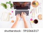 feminine workspace   laptop ... | Shutterstock . vector #591066317