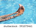 spa  swimming and rest. feet in ... | Shutterstock . vector #591075461