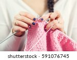 The Woman Knits Woolen Clothes...