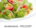 close up of salad on white plate