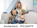 Happy Soldier And His Family A...