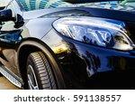headlights of a black car | Shutterstock . vector #591138557