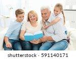 senior couple reading book to...   Shutterstock . vector #591140171