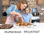 portrait of mother putting... | Shutterstock . vector #591147437