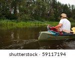man fishing in river from canoe | Shutterstock . vector #59117194