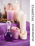 Small photo of Bottles with essential aroma oil and aroma candles. Spa setting