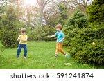 kids on easter egg hunt in... | Shutterstock . vector #591241874