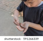 Image Of Young Asian Boy Hold...