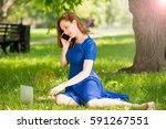 smiling girl sitting on the...   Shutterstock . vector #591267551