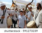 Small photo of JERUSALEM / ISRAEL - JULY 14 : Family celebration age of majority son according to the Jewish custom by the Western Wall of the temple on 14.07.2014 in Jerusalem, Israel.