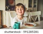 cute little boy eating his... | Shutterstock . vector #591285281