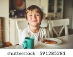 cute little boy eating his