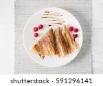 three russian thin pancakes and ... | Shutterstock . vector #591296141