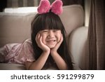 portrait of cute little asian... | Shutterstock . vector #591299879