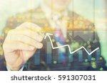 businessman hand drawing a... | Shutterstock . vector #591307031