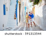 happy family of four in greek... | Shutterstock . vector #591313544