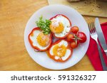 fried eggs in red peppers in a... | Shutterstock . vector #591326327